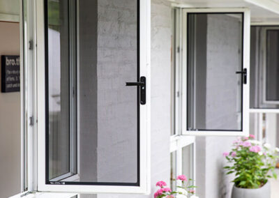Security Screens QLD Gallery - Stainless Steel Corner Stacker Doors
